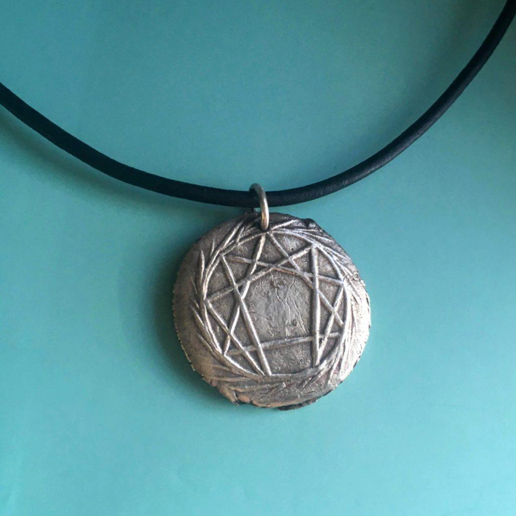 silver enneagram pendant